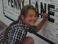 Signing the Penny Lane wall!