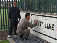 Grandmaster Chen Xiao Wang signing the Penny Lane wall